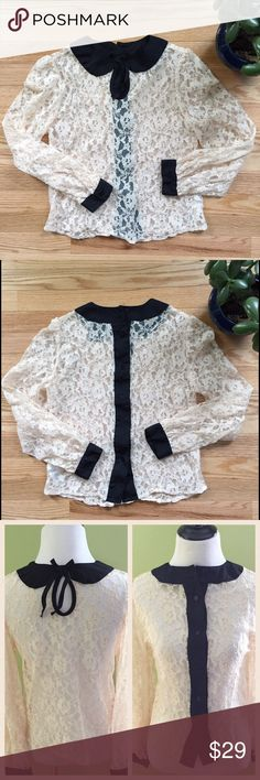 """ASOS Lace Blouse with Black Peter Pan Collar Gorgeous lace Blouse with a black Peter Pan collar and black trim cuffs. Featuring a button down back, this top measures 16"""" across the Bust. Length 21""""; Sleeve 22. Lace is 100% nylon. Trim is 100% polyester. EUC. ASOS Tops Blouses"""