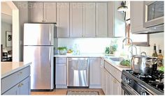 DIY PAINTED KITCHEN CABINETS: greige paint, painted white tile backsplash, brass hardware