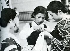 Japanese women stitching a senninbari (thousand stitch belt) for a male member of the family who was in the military and was being shipped out to China, 1937