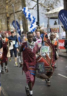 Masai warriors from Tanzania compete in traditional dress to raise money to provide their village with water. If you look closely you can see that they have old car tires as shoes. - London 2008
