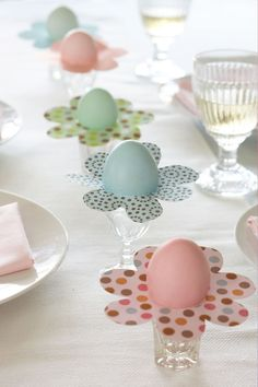 Wondering what to do with those darling dyed eggs your family made in all colors of the rainbow? Here is the solution:  Cut out a flower shape, then cut a circle of 1 3/4 inches in the middle so that the egg will drop snuggly in.  This is a great project for kids too.