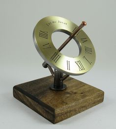 Finished product. The brass face has been etched, attached to a steel substrate and the rest of the sundial completed.