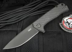 This is the Zero Tolerance - Todd Rexford design 0804CF with a razor sharp stainless CTS 204P with a black DLC coating. Machined titanium handle on the locking side has black anodizing that matches the blade. Black carbon fiber on the face side of the 0804CF reduces weight and gives the knife a great look. Titanium frame lock design. Flipper for easy right or left hand opening. Flipper serves as an index finger guard in the open position. KVT ball-bearing pivot system for fast and smooth…