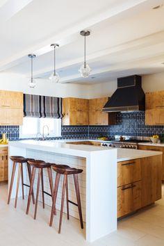 Megan Tagliaferri from FLO design studio's Long Beach Home #kitchen #patterns #textures #design #barstools #lighting #gold #brass #black #island