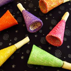 Dip an ice cream cone in white chocolate, sprinkle on some colorful sugar to create these edible horns for your New Year's Eve parties.