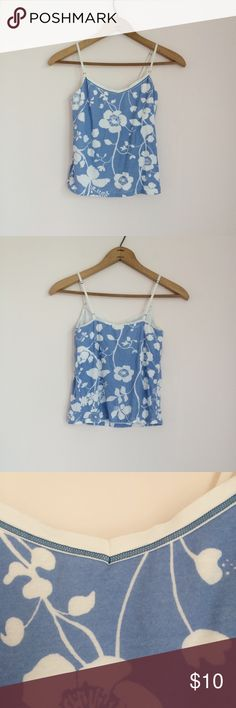 J Crew Floral Crop Tank Blue and white floral print cropped tank. Size S. Just covers my belly button. Built in shelf bra. Adjustable straps. Very good condition, no flaws. Tops Crop Tops