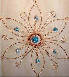 This listing is for a Large hand crafted sparkling copper FLOWER creation br br This large FLOWER suncatcher is hand crafted of numerous bare solid copper spirals that are cradling Wire Crafts, Bead Crafts, Wire Wrapped Jewelry, Wire Jewelry, Jewellery, Wire Jig, Wire Ornaments, Diy Wind Chimes, Wire Flowers