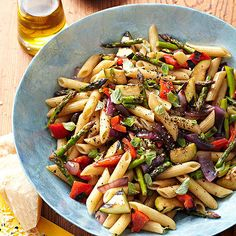 Crisp-tender asparagus, sweet peppers, zucchini, and red onion hot off the grill join cooked penne for one fantastic pasta salad. A light drizzle of balsamic vinegar coats the 30-minute side dish.
