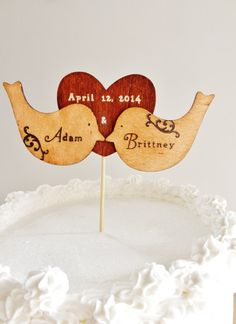 This handmade cake topper can be personalized with any words of your choice. Some great examples are your name and your soon to be partners