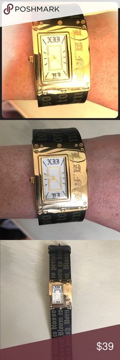 L.A.M.B. Gwen Stefani watch, black and gold This cuff style watch by L.A.M.B. Gwen Stefani features black leather with gold Old English style writing (Gwen Stefani lyrics) and a gold face sight small ruby dial. It needs new batteries but still runs. I will also try to update with the original packaging, as I know I still have it around here somewhere. Still in excellent condition! L.A.M.B. Accessories Watches