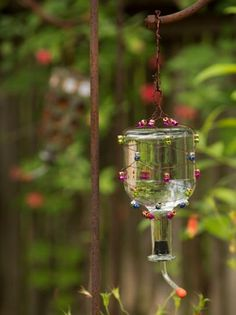 DIY Network shows you how to make a beaded hummingbird feeder for your garden using an empty tequila bottle.