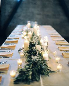 Greenery with mixed flowers, varying sized, votive candles  - A California Wedding at The Mountain Winery - MODwedding