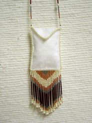 """Native American Yacqui Made White Linen Medicine Bag - This delicately beaded medicine bag was created by Yacqui artist Deer Dancer. A beautiful piece with a beaded strap of pearls and glass beads that is 26 inches long. Dimensions: 3"""" x 2.5"""" x 3"""" fringe.  $69.95"""