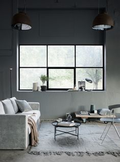 Moody shades | Grey velvet sofa | round minimalist coffee table | industrial living room Scandinavian minimalism | industrial style window | IKEA Vimle sofa with a Bemz cover in Zinc Grey Malmen velvet | styled by Pella Hedeby