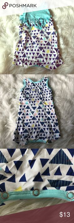 Sleeveless Onesie Tribal Blues Baby sleeveless Onesie with 3 buttons. Baby blue on top with fringe. Multiple tribal triangles with different shades of blue, stripes, yellow and pink. 100% Cotton. Super comfy and stretchy for your Littles! Perfect for a picnic play date!! One Pieces Bodysuits