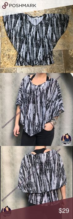 NWT Double layer top by Shannon Ford Shannon Ford - Inner layer is a slightly stretchy fitted tank, outer layer is flowy high in back & low in front. 95% polyester 5% spandex chiffon.  NEW WITH TAGS •  Bundle for 10% off    • 5 star rating  •. Fast shipper  • 100+ sales  • smoke free home  • 100% authentic   N O   TRADES Shannon Ford Tops