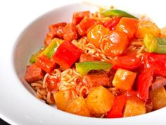 Sweet & Sour Ramen SWEET & SOUR RAMEN It's tacky, it's bright red, it's made with ketchup, but it's good. Cook the ramen just until they break apart, then drain and set aside. Heat a tablespoon of oil in a wok or skillet and stir-fry some bell pepper along with a few chunks of spam until everything's nice and hot (or if you'd really like, some pork or chicken pieces). Add a small can of pineapple chunks along with their juice, a half cup of ketchup, and chili-garlic sauce to taste. Toss with…
