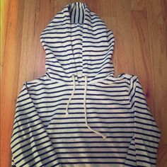 Sweatshirt Nautical style sweatshirt. Side gold zipper slits. Front pockets which I love! Cute fit, slightly boxy. Light wear. No noticeable staining. Ivory with navy stripes J. Crew Tops Sweatshirts & Hoodies