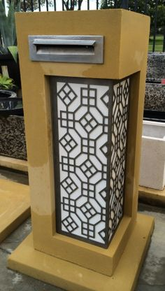 Sandstone Medusa Letterbox with white perspex and laser cut screen - standard front plate