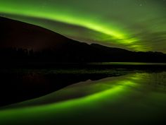 Aurora Borealis - A fantastic northern light reflecting in the water. One of nature's best maracles.