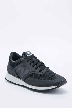 New Balance 620 Runner Trainers in Sleek Black - Urban Outfitters