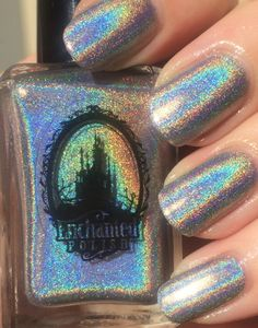 DIME PIECE - Enchanted Polish -  holidays 2013 - Beautiful silver w/very, very strong rainbow holo - use Glitter Gal top coat. 2 thin coats  NOTES: may be the most holographic polish ever made! STUNNING!!!