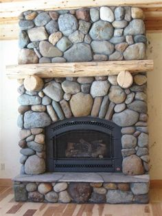 river rock fireplace – I kind of like the big rocks for the dining room Cabin Fireplace, Brick Fireplace Makeover, Living Room With Fireplace, Fireplace Design, Fireplace Facade, Fireplace Ideas, Basement Fireplace, Black Fireplace, Farmhouse Fireplace