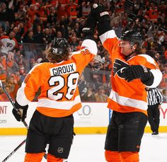 Scott Hartnell #19 of the Philadelphia Flyers celebrates his goal with coattail-rider Glaude Giroux #28.