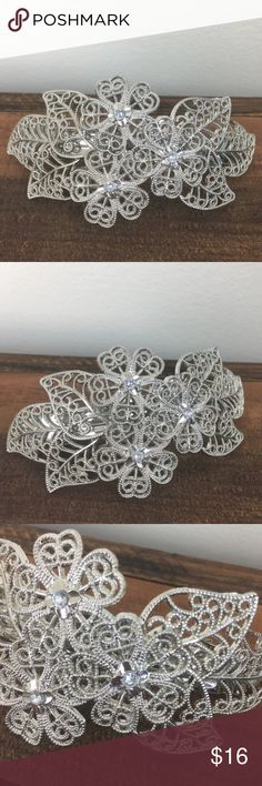 Elf Silver Metal Barrette with Rhinestones This floral, silver toned metal barrette features three rhinestones and a slight curve for comfort. Accessories Hair Accessories