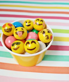 Emoji party activity and treat: Decorate emoji gumballs with edible paint pens!