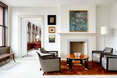 The decorative stone border from the floor continues onto the fireplace in the home's living room. Over the mantel hangs an untitled work by Roberto Matta Living Room Modern, Interior Design Living Room, Living Area, Manhattan Penthouse, Manhattan Apartment, Moldings And Trim, Living Room With Fireplace, Architectural Digest, Living Room Inspiration