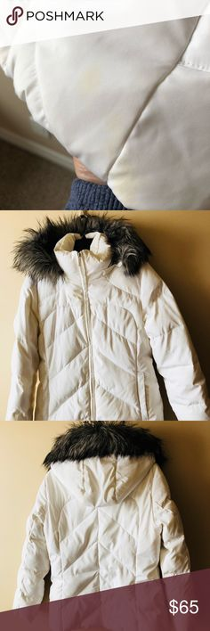 """Calvin Klein Down Puffy Jacket Medium Calvin Kline washable down puffy coat sized M.  Coat is very warm with a detachable faux fur trimmed hood.  Multiple interior pockets to Stacy all your goodies.  Outside pockets are zippered.   26"""" in length.  There is a small stain on the front right under the pocket.  It shows in one of the pics Calvin Klein Jackets & Coats Puffers"""