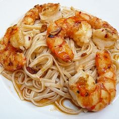 Juicy King Prawns pan-fried with Garlic and tossed together with Linguine and a Fragrant Prawn Oil.