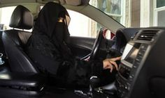 A woman drives a car in Saudi Arabia