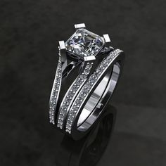 Wedding band with Diamond centre and Diamond sides Style: Decorative Setting, Cathedral, Split, Euro Shank