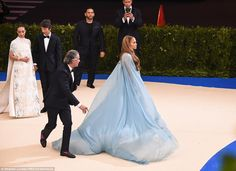 MET GALA 2017 JLo All eyes on her! An aide rushed to help Jennifer Lopez as she made her way toward the stai...