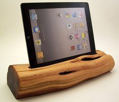 RockAppleWood specializes in making all types of docking stations for Apple products from salvaged wood recovered from the foothills of California. This iPad dock is made of Manzanita wood — salvaged from a tree lost due to the expansion of a local community college.