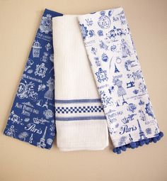 Paris Folie Blue Assorted Kitchen Towels by Plaid Parasol. Dream of Paris as you dry the dishes with this set of blue and white kitchen towels with designs as charming as the city itself. Set of 3. With blue color and white print, and pompom details. http://www.zocko.com/z/JEUEl