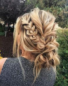 this braided updo is messy, but also elegant. artfully messy maybe? boho chic? what do you think?