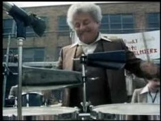 "Tito Puente performing in NY's ""El Barrio"" also known as Spanish Harlem.  Tito is playing with Charlie Palmieri-Eddie Palmieri's brother."