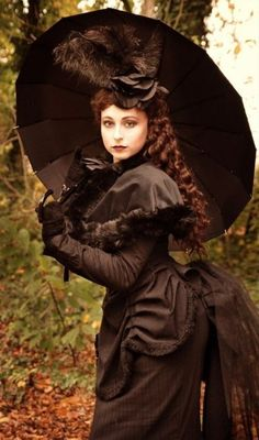 This is what I envision for a steampunk costume.  The perfect Victorian ensemble.  I particularly like the bustle and the hat.