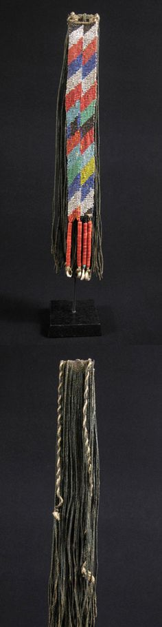 Africa | Cache-sex from the Kirdi tribe of Cameroon | Fiber, glass beads, shells | Early to mid 20th century