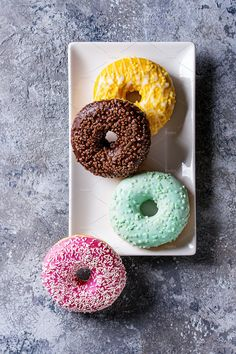 Colorful glazed donuts Photos Variety of colorful glazed donuts on square plate over gray texture background. Top view with space by Natasha Breen Healthy Donuts, Delicious Donuts, Yummy Food, Yummy Treats, Sweet Treats, Amazing Food Photography, Breakfast Photography, Colorful Donuts, Donut Glaze