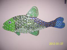 Fish beer bottle cap art. Check us out on Facebook!
