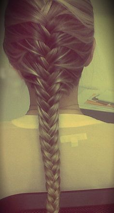 This is exactly how i wish i could do my hair- low thick strand french fishtail