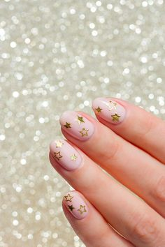 Minimalist nail art - Gold Star Nails for Christmas  --- The Perfect Party Manicure. Video Tutorial Provided!
