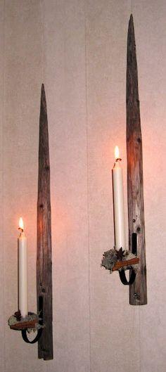 Old Scandinavian hay poles as candleholders | Höstörar
