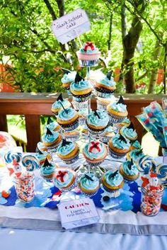 Shark party. Shark cupcakes. So cute.