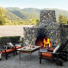 Achievable Outdoor fireplace: This friendly looking fireplace sits on a gravel patio, accompanied by a traditional arrangement of furniture. The structure was built from concrete blocks and covered with manmade, though convincing, river-rock veneer.