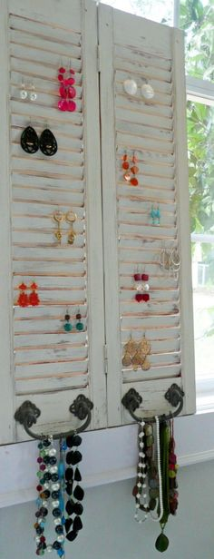 I did this and LOVE it!  Mine was only on shutter and used an old glass doorknob for necklaces instead of hinges.